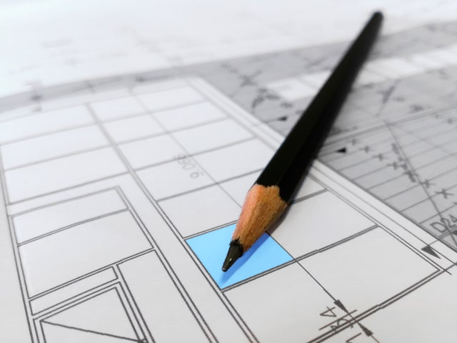 Image of building plans and pencil